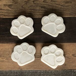 Set of four, stone, paw print coasters.
